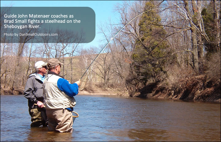 Guide John Matenaer coaches as Brad Small fights a steelhead on the Sheboygan River.